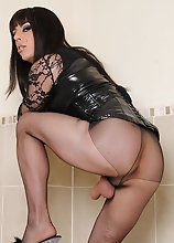 Zoe puts on some gorgeous nylon stockings and fluffy high heels and then masturbates her big cock in the bathroom.