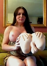 Busty transsexual Wendy playing with her toy ass