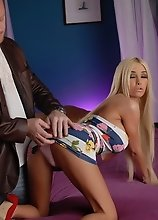 Busty Kimber James riding a fat cock