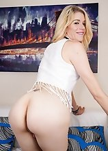 Slim blonde shemale Cassie Sparkles posing and playing with her cock in smoking hot solo scene!
