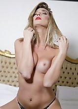 Watch Angelina as she strips naked on her bed and jacks off her hard thick dick!