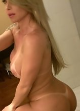Carla Novaes takes selfies of her hot body, massive rack and huge throbbing tranny dong